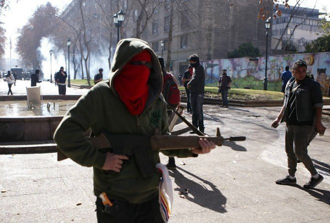 Infiltrado nas marchas estudantis no Chile
