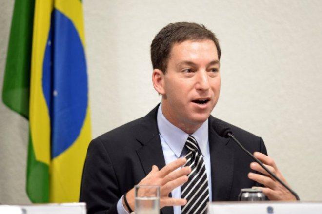 Greenwald explicou que não pode revelar informações às autoridades brasileiras EVARISTO SÁ/AFP