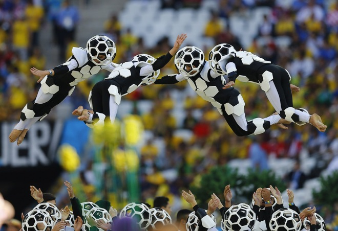 Performers are thrown into the air during the 2014 World Cup opening ceremony at the Corinthians arena in Sao Paulo