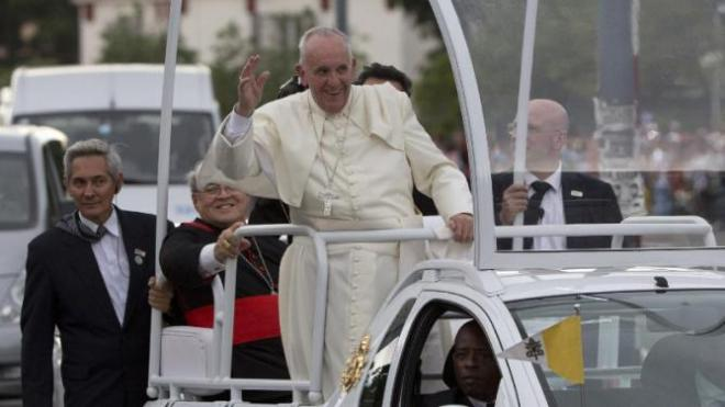 Pope Francis waves to people from his popemobile as he arrives to the Apostolic Nunciature in Havana, Cuba, Saturday, Sept. 19, 2015. Pope Francis began his 10-day trip to Cuba and the United States, embarking on his first trip to the onetime Cold War foes after helping to nudge forward their historic rapprochement. (AP Photo/Alessandra Tarantino)